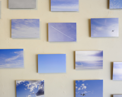 Close-up of Stephen Clamers' 'Limbo' photographs at the Air Travel Exhibition at Corridor 2122